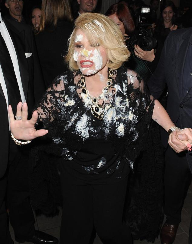 The 80-year-old star was seen rushing out of the QVC Red Carpet Style party Friday covered in icing after an argument with Miss Piggy.  Read more: http://www.nydailynews.com/entertainment/gossip/joan-rivers-caked-face-pre-oscar-party